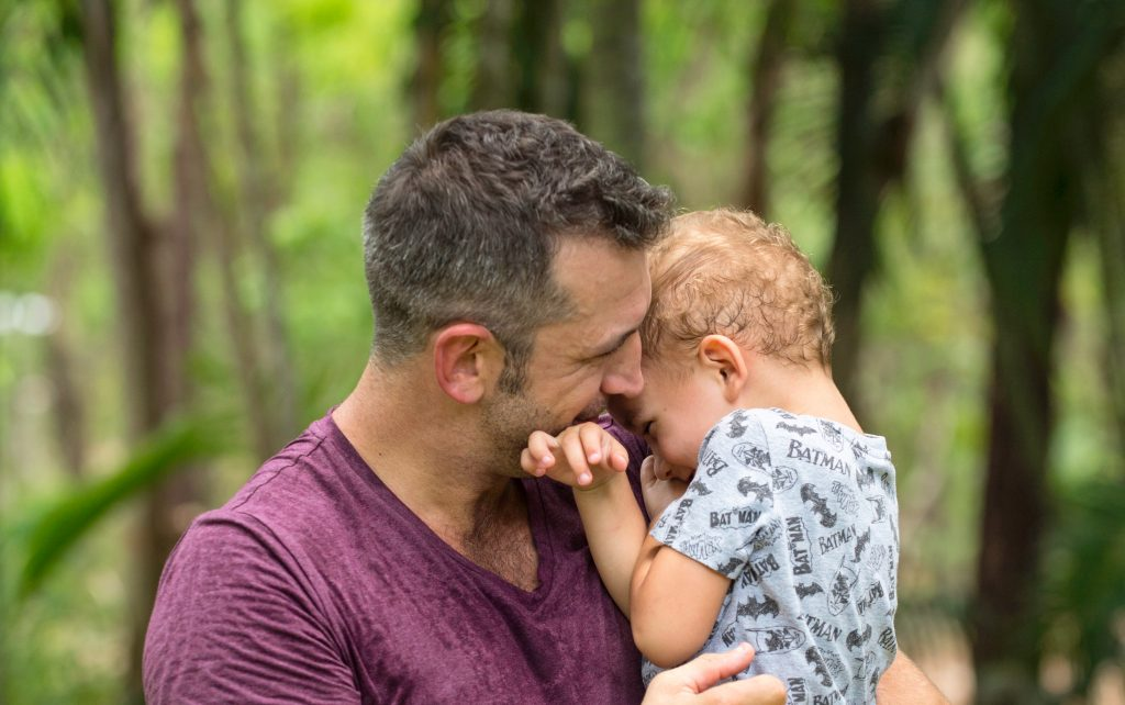 Brent Lang cuddles his baby
